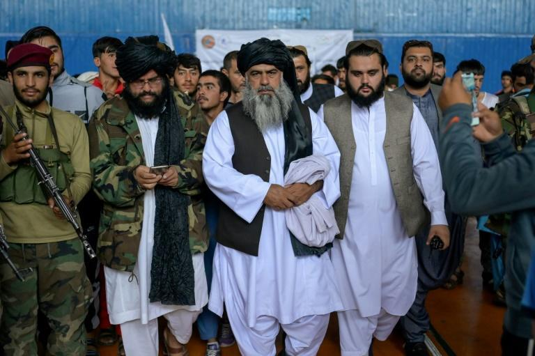 Afghanistan's new director general for sports and physical education Bashir Ahmad Rustamzai (C) served as the wrestling federeation chief when the Taliban were last in power (AFP/BULENT KILIC)
