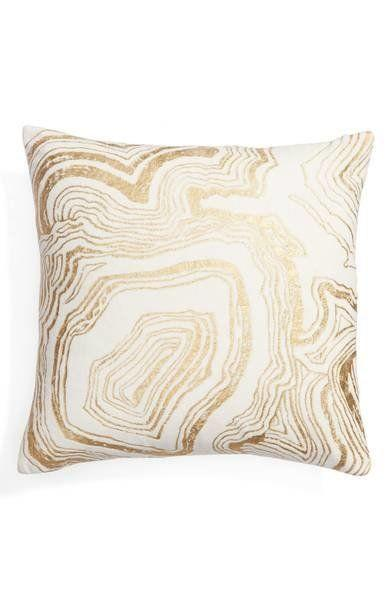 "Get it <a href=""https://shop.nordstrom.com/s/nordstrom-at-home-foil-print-pillow/4611053?origin=category-personalizedsort&fashioncolor=PINK%20HERO"" target=""_blank"">here</a>."