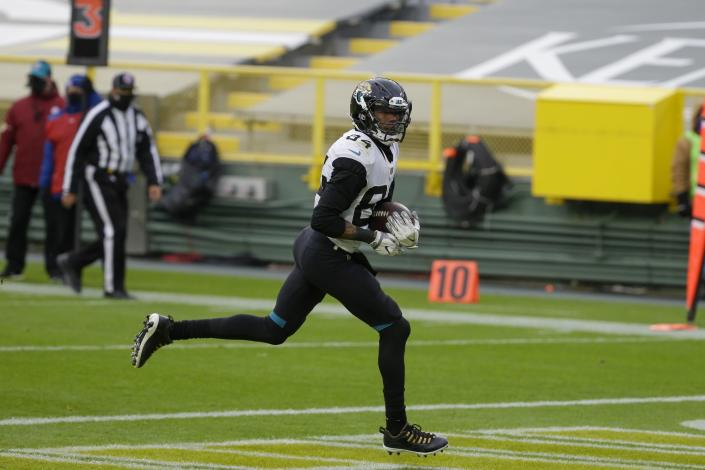 Jacksonville Jaguars' Keelan Cole catches a touchdown pass during the second half of an NFL football game against the Green Bay Packers Sunday, Nov. 15, 2020, in Green Bay, Wis. (AP Photo/Mike Roemer)
