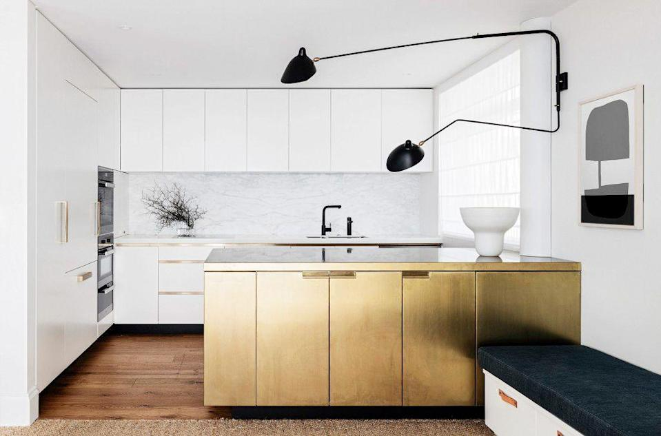 <p>There's nothing quite like metallic to make your interiors pop. Opt for a brushed gold finish on the kitchen cabinets and introduce more down to earth materials like jute to make sure it isn't too flashy, like in this Arent & Pyke-designed kitchen.</p>