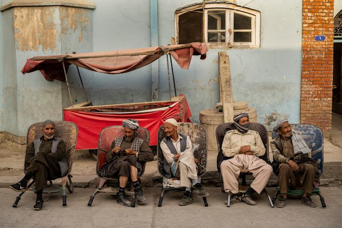 September 12, 2021: Laborers wait in the street to be hired, in Kabul, Afghanistan.