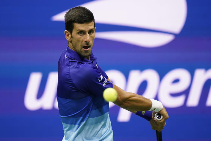 Novak Djokovic, of Serbia, returns a shot to Tallon Griekspoor, of the Netherlands, during the second round of the US Open tennis championships, Thursday, Sept. 2, 2021, in New York. (AP Photo/Frank Franklin II)