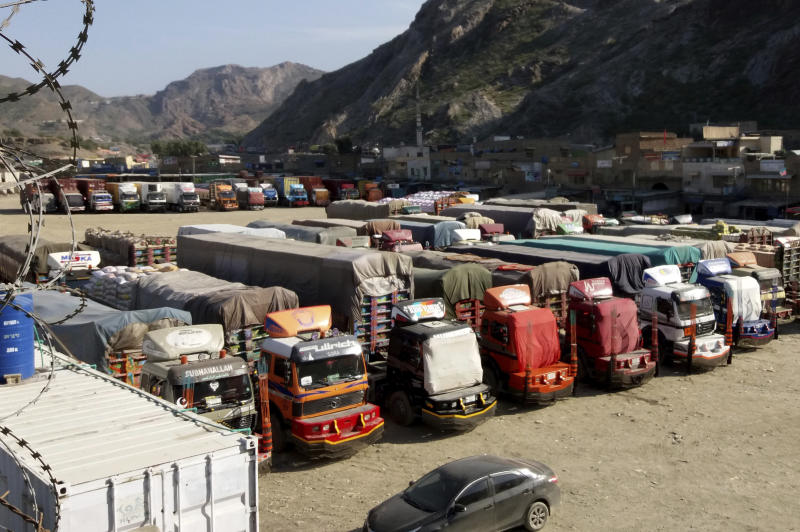 Trucks are parked at Pakistan-Afghanistan border Torkham, Friday, Oct. 19, 2018. Pakistan closed its two official border crossings with Afghanistan, the foreign ministry said. The development came at the request of the Afghan government, which routinely accuses Pakistan of harboring Taliban militants, a charge Islamabad denies. The crossings would remain closed Friday and Saturday. (AP Photo/Qazi Rauf)