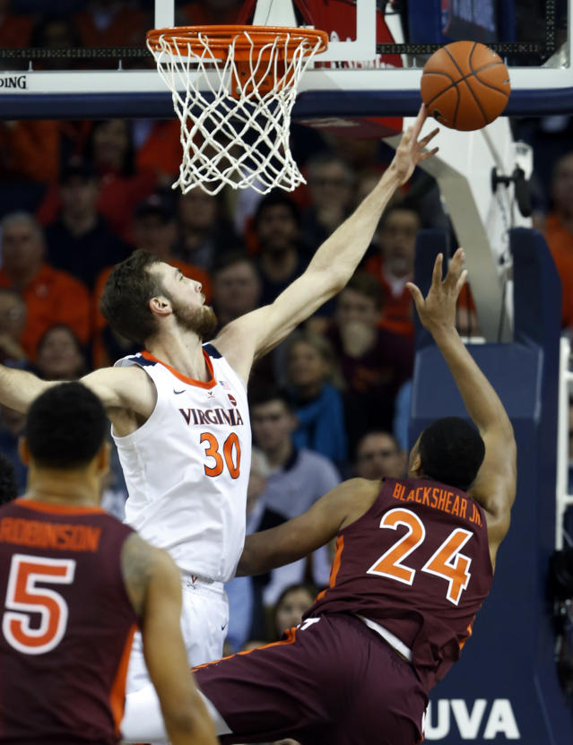 Virginia forward Jay Huff (30) blocks s shot by Virginia Tech forward Kerry Blackshear Jr. (24) during the first half of an NCAA college basketball game in Charlottesville, Va., Tuesday, Jan. 15, 2019. (AP Photo/Steve Helber)