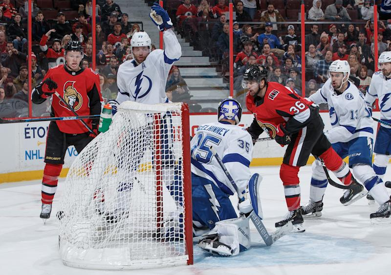 OTTAWA, ON - JANUARY 4: Colin White #36 of the Ottawa Senators head-buts the puck into the back of the net against Curtis McElhinney #35 and Victor Hedman #77 of the Tampa Bay Lightning at Canadian Tire Centre on January 4, 2020 in Ottawa, Ontario, Canada. (Photo by Andre Ringuette/NHLI via Getty Images)