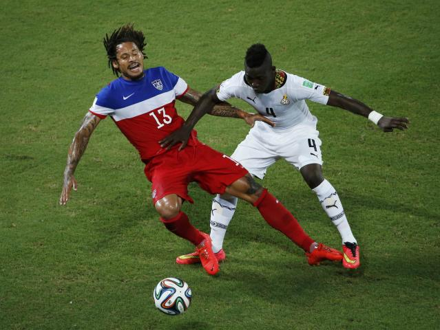 Ghana's Daniel Opare (R) fights for the ball with Jermaine Jones of the U.S. during their 2014 World Cup Group G soccer match at the Dunas arena in Natal June 16, 2014. REUTERS/Carlos Barria (BRAZIL - Tags: SOCCER SPORT WORLD CUP)