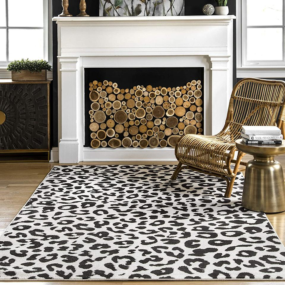 """<h2><a href=""""https://www.amazon.com/dp/B085WTFL9W/ref=sspa_dk_detail_2?th=1"""" rel=""""nofollow noopener"""" target=""""_blank"""" data-ylk=""""slk:nuLOOM Leopard Print Area Rug"""" class=""""link rapid-noclick-resp"""">nuLOOM Leopard Print Area Rug</a></h2><br>We love things all animal print, and this leopard moment is no exception.<br><br><strong>nuLOOM</strong> nuLOOM Leopard Print Area Rug, $, available at <a href=""""https://www.amazon.com/dp/B085WTFL9W/ref=sspa_dk_detail_2?th=1"""" rel=""""nofollow noopener"""" target=""""_blank"""" data-ylk=""""slk:Amazon"""" class=""""link rapid-noclick-resp"""">Amazon</a>"""