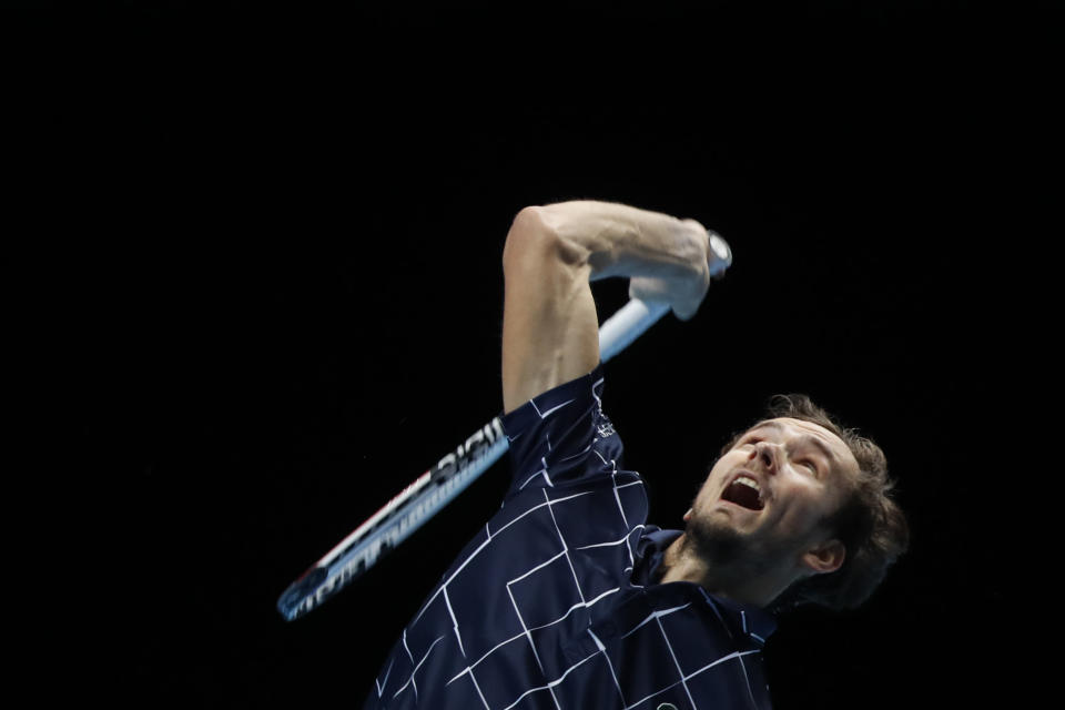 Daniil Medvedev of Russia serves the ball to Rafael Nadal of Spain during their semifinal match at the ATP World Finals tennis tournament at the O2 arena in London, Saturday, Nov. 21, 2020. (AP Photo/Frank Augstein)