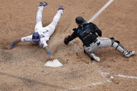New York Mets' Javier Baez scores the game winning run past Miami Marlins catcher Alex Jackson during the ninth inning of the first game of a baseball doubleheader that started April 11 and was suspended because of rain, Tuesday, Aug. 31, 2021, in New York. The Mets won 6-5. (AP Photo/Adam Hunger)