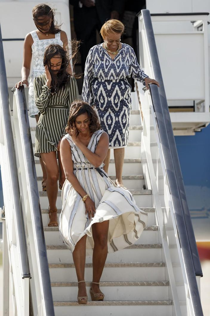 <p>First lady Michelle Obama, followed by her daughter Malia Obama, center left, her mother Marian Shield Robinson, and her daughter Sasha Obama, walk down the stairs of the plane as they arrive at Torrejon de Ardoz military base near Madrid, Spain, Wednesday, June 29, 2016. (AP Photo/Daniel Ochoa de Olza) </p>