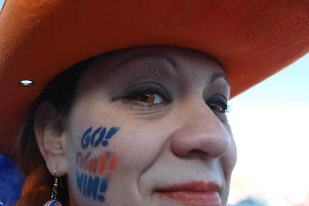 Denver Broncos fan Antasia Amador, of Denver, shows off her orange-colored eyes as part of her support for the team as they face the New England Patriots at the AFC Championship NFL football game in Denver, Sunday, Jan. 19, 2014. (AP Photo/David Zalubowski)