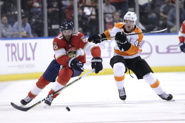 Florida Panthers right wing Brett Connolly (10) skates with the puck as Philadelphia Flyers' Joel Farabee (49) defends during the second period of an NHL hockey game, Tuesday, Nov. 19, 2019, in Sunrise, Fla. (AP Photo/Lynne Sladky)