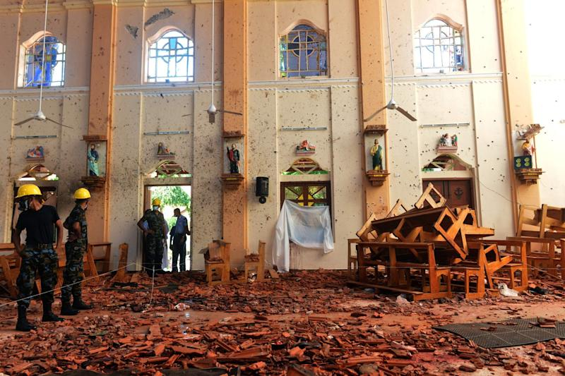 Security personnel inspect the interior of St. Sebastian's Church in Negombo (AFP/Getty Images)