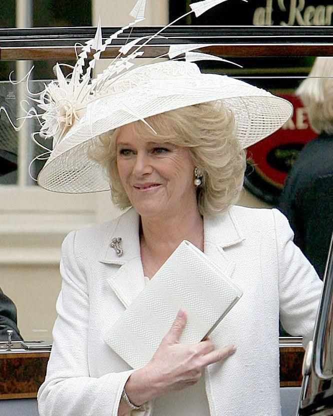 """<p>When Camilla tied the knot with Prince Charles in 2005, she wore a large cream-colored hat for the civil ceremony in Windsor.</p><p><strong><a href=""""https://www.townandcountrymag.com/society/tradition/g19135643/prince-charles-camilla-wedding-photos/"""" rel=""""nofollow noopener"""" target=""""_blank"""" data-ylk=""""slk:See more photos from Charles and Camilla's Wedding Day here."""" class=""""link rapid-noclick-resp"""">See more photos from Charles and Camilla's Wedding Day here.</a></strong><br></p>"""