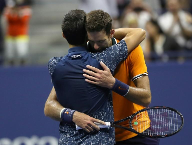 Best of friends: Novak Djokovic and Juan Martin del Potro embrace