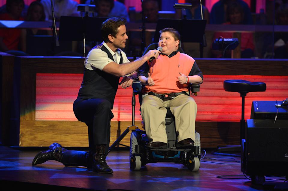 Actor Chip Esten and former MDA Spokesman Bryson Foster announced musical guests at the last held MDA telethon, in 2014, at the Grand Ole Opry House in Nashville, Tenn. (Photo: Jason Davis/Getty Images for the Muscular Dystrophy Association)