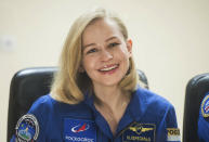 In this handout photo released by Roscosmos, actress Yulia Peresild attends a news conference at the Russian launch facility in the Baikonur Cosmodrome, Kazakhstan, Monday, Oct. 4, 2021. In a historic first, Russia is set to launch an actress and a film director to space to make a feature film in orbit. Actress Yulia Peresild and director Klim Shipenko are set to blast off Tuesday for the International Space Station in a Russian Soyuz spacecraft together with Anton Shkaplerov, a veteran of three space missions. (Roscosmos Space Agency via AP)