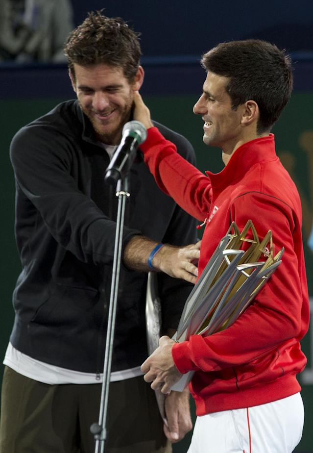 Serbia's Novak Djokovic, right, celebaretes with Argentina's Juan Martin del Potro during the award ceremony at the Shanghai Masters tennis tournament at the Qizhong Forest Sports City Tennis Center in Shanghai, China, Sunday, Oct. 13, 2013. Djokovic won the final match 6-1, 3-6, 7-6 (3). (AP Photo/Ng Han Guan)