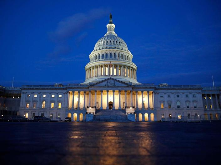 Light shines on the US Capitol dome in Washington, early Wednesday 4 December: AP