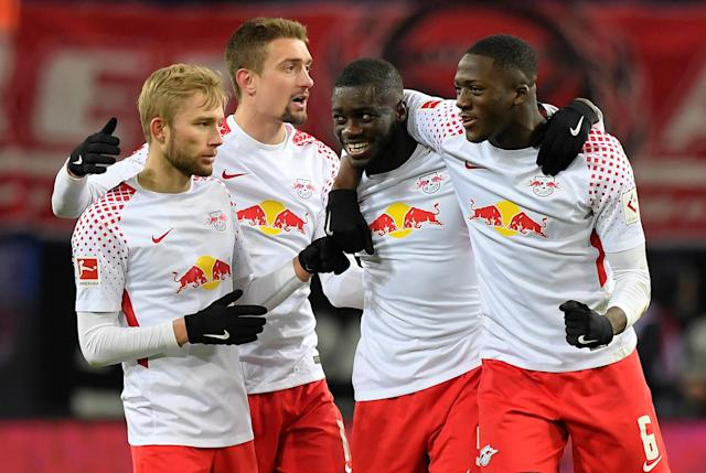 Soccer Football - Bundesliga - RB Leipzig vs Bayern Munich - Red Bull Arena, Leipzig, Germany - March 18, 2018 RB Leipzig's Ibrahima Konate, Dayot Upamecano, Konrad Laimer and team mates celebrate after the match REUTERS/Matthias Rietschel DFL RULES TO LIMIT THE ONLINE USAGE DURING MATCH TIME TO 15 PICTURES PER GAME. IMAGE SEQUENCES TO SIMULATE VIDEO IS NOT ALLOWED AT ANY TIME. FOR FURTHER QUERIES PLEASE CONTACT DFL DIRECTLY AT + 49 69 650050