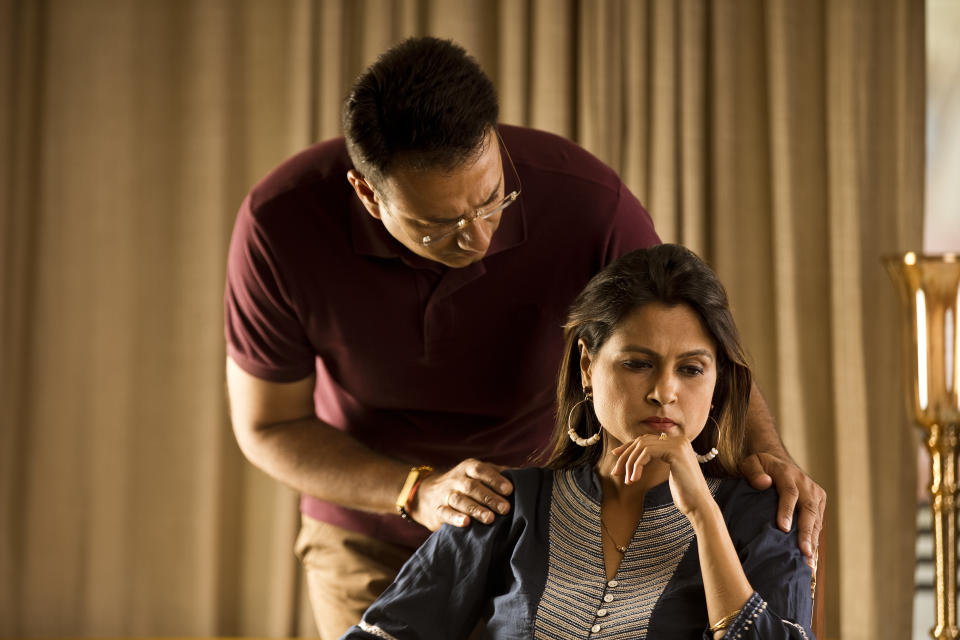 Man comforting wife suffering with depression at home