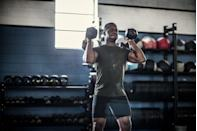 """<p><strong>You'll need: 2 x dumbbells, floor space, weight bench or raised area</strong></p><p>In this home workout, you should be able to complete 1 round in 2 to 3 minutes based on your body size and fitness level. If you can get it done in less than 2 minutes, bump up the load. If it takes you more than 3 minutes, lighten the load. Perform each move for 7 reps with little to no rest between moves in the exact order shown. Rest 1 to 2 minutes. That's 1 round. Perform up to 7 rounds.</p><p><strong>1. Overhead Triceps Extension</strong></p><p>Grab your dumbbell and stand with your feet shoulder-width apart. Raise <a href=""""https://www.menshealth.com/uk/workouts/a34739638/dumbbell-home-workout-back-chest-abs/"""" rel=""""nofollow noopener"""" target=""""_blank"""" data-ylk=""""slk:the dumbbell"""" class=""""link rapid-noclick-resp"""">the dumbbell</a> so that it's behind your head. Bending at the elbows and keeping your upper arm set, lower the dumbbells until they are about level with your shoulder blades. Squeeze your triceps and raise the dumbbell back to the starting position.</p><p><strong>2. Hammer Curl</strong></p><p>Hold a dumbbell in each hand at your sides, palms facing your hips. Curl the weights up until your thumbs are near your shoulders, then lower.</p><p><strong>3. Push Press</strong></p><p>Grab <a href=""""https://www.menshealth.com/uk/gym-wear/g33023121/best-adjustable-dumbbells/"""" rel=""""nofollow noopener"""" target=""""_blank"""" data-ylk=""""slk:your dumbbells"""" class=""""link rapid-noclick-resp"""">your dumbbells</a> and hold them at shoulder height with palms facing forwards. Set your feet shoulder-width apart and slightly bend your knees to initiate the move. Push up with your legs to explosively press the dumbbells straight above your head. Return under control to the start position.</p><p><strong>4. Bent-over Row</strong></p><p>Grab your dumbbells and have your hands slightly wider than shoulder-width apart. With your legs slightly bent, keep your back perfectly straight and bend your upper bo"""