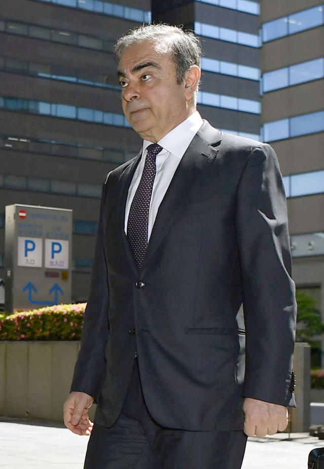 Former Nissan chairman Carlos Ghosn arrives at Tokyo District Court for a pre-trial meeting in Tokyo Thursday, May 23, 2019. Ghosn, who is out on bail, has been charged with under-reporting his post-retirement compensation and breach of trust in diverting Nissan money and allegedly having it shoulder his personal investment losses., lawyer of (Ren Onuma/Kyodo News via AP)