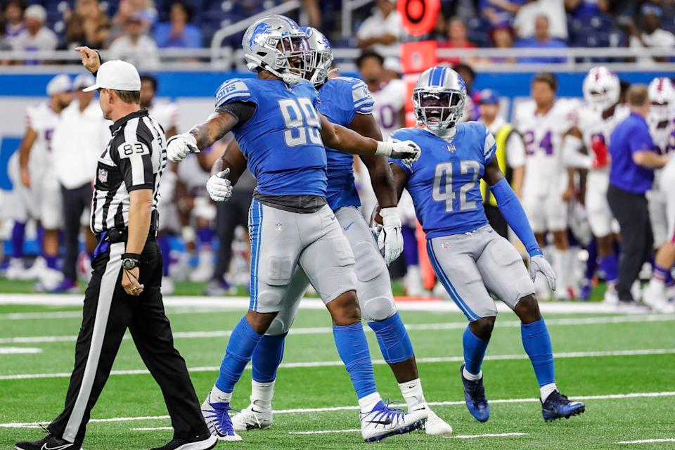 Detroit Lions defensive end Julian Okwara (99) celebrates a play against the Buffalo Bills during the second half of the preseason game at Ford Field in Detroit on Friday, Aug. 13, 2021.