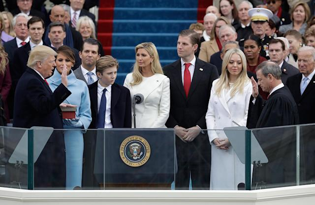 <p>JAN. 20, 2017 – Donald Trump is sworn in as the 45th president of the United States by Chief Justice John Roberts as Melania Trump and his family looks on during the 58th Presidential Inauguration at the U.S. Capitol in Washington, D.C. (Photo: Patrick Semansky/AP) </p>
