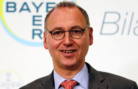 FILE PHOTO: Werner Baumann, CEO of Bayer AG poses for a picture during the annual results news conference of the German drugmaker in Leverkusen