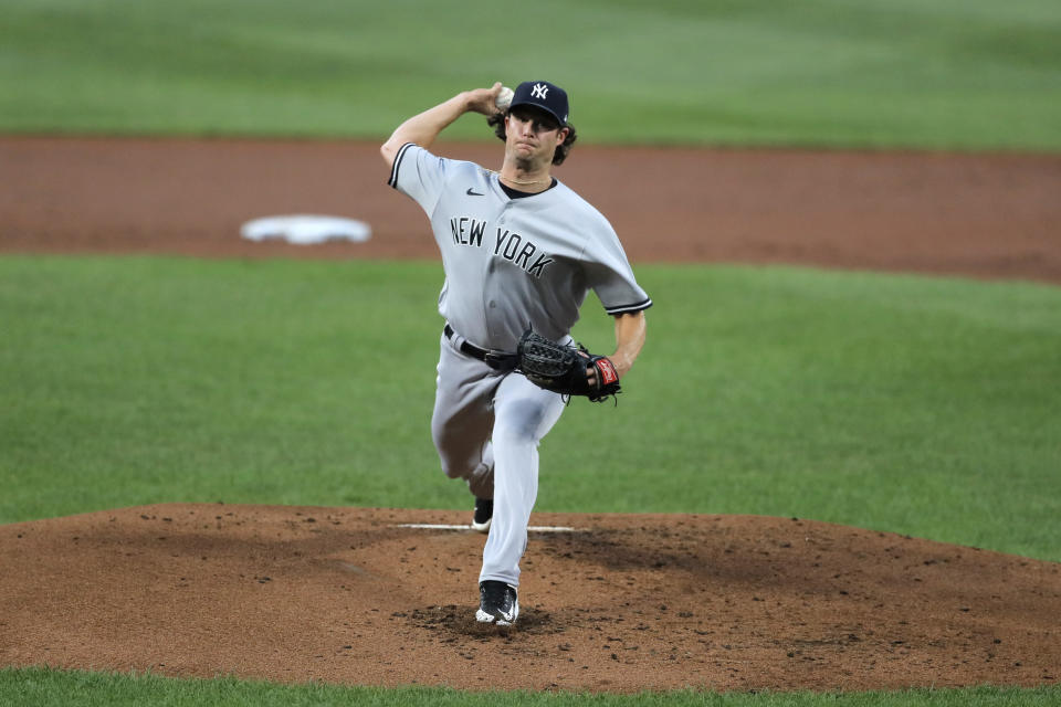 New York Yankees starting pitcher Gerrit Cole throws a pitch to the Baltimore Orioles during the first inning of a baseball game, Wednesday, July 29, 2020, in Baltimore. (AP Photo/Julio Cortez)