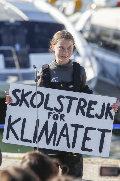 "Climate activist Greta Thunberg holds a ""Fridays for Future"" banner in Lisbon, Tuesday, Dec 3, 2019. Thunberg has arrived by catamaran in the port of Lisbon after a three-week voyage across the Atlantic Ocean from the United States. The Swedish teen sailed to the Portuguese capital before heading to neighboring Spain to attend the U.N. Climate Change Conference taking place in Madrid. The banner reads in Swedish "" school strike for the climate"". (AP Photo/Armando Franca)"