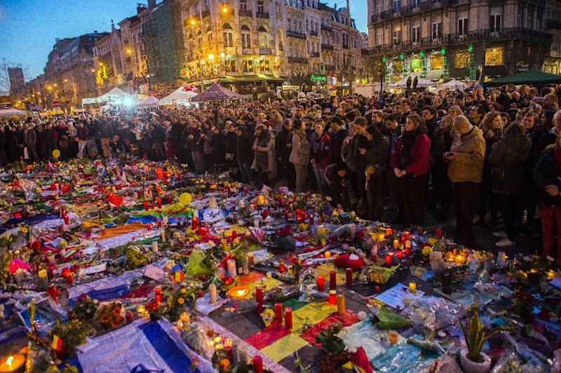 People gather at a makeshift memorial in tribute to the victims of the Brussels terror attacks, on Place de la Bourse square in Brussels, on March 25, 2016