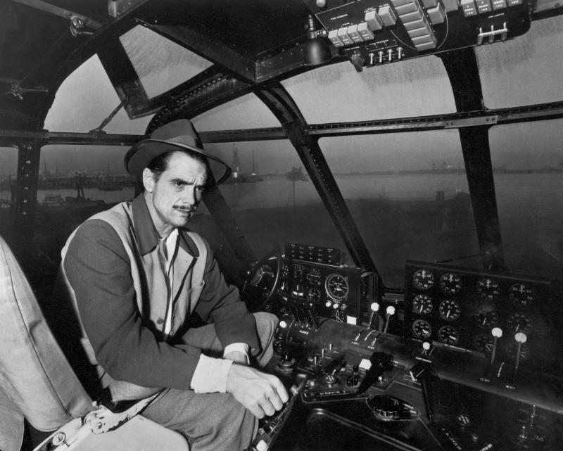 American industrialist, aviator, and film producer Howard Hughes (1905 - 1976) sits in the cockpit of the Spruce Goose, a massive sea plane designed and built by Hughes, Los Angeles, November 6, 1947. (Photo by J.R. Eyerman/The LIFE Picture Collection via Getty Images)