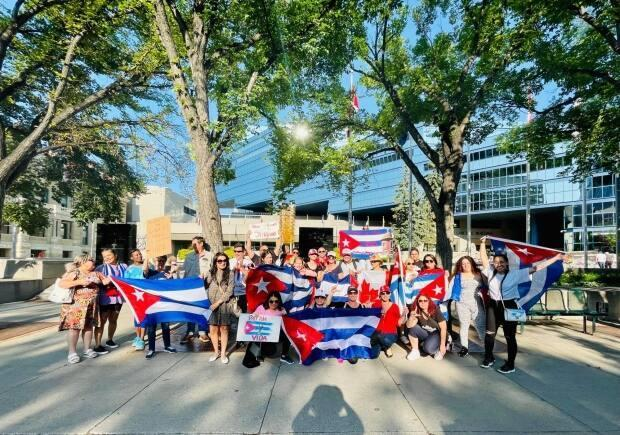 Cuban Calgarians held a protest on Sunday at City Hall in solidarity with Cuba's anti-government protestors.   (Submitted by Yisleidys Marrero - image credit)