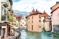"""<p><strong>Population:</strong> 125,694</p> <p>Sometimes called """"the <a href=""""https://www.cntraveler.com/story/the-locals-guide-to-venice?mbid=synd_yahoo_rss"""" rel=""""nofollow noopener"""" target=""""_blank"""" data-ylk=""""slk:Venice"""" class=""""link rapid-noclick-resp"""">Venice</a> of Savoie,"""" this lakeside Alpine town is treasured for its sloping hillsides, and the canals that wind their way through the town's streets. Pro tip: The small stone bridges over the canals make for perfect photo ops. While its population might be bigger than this list's other entries, Annecy's cobblestone streets and pastel-colored facades provide the same storybook feel that you'd find in some of France's tiniest villages.</p>"""