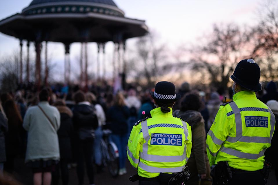 LONDON, ENGLAND - MARCH 13: People gather to lay flowers and pay their respects at a vigil on Clapham Common, where floral tributes have been placed for Sarah Everard on March 13, 2021 in London, England. Vigils are being held across the United Kingdom in memory of Sarah Everard. Yesterday, the Police confirmed that the remains of Ms Everard were found in a woodland area in Ashford, a week after she went missing as she walked home from visiting a friend in Clapham. Metropolitan Police Officer Wayne Couzens has been charged with her kidnap and murder. (Photo by Leon Neal/Getty Images)