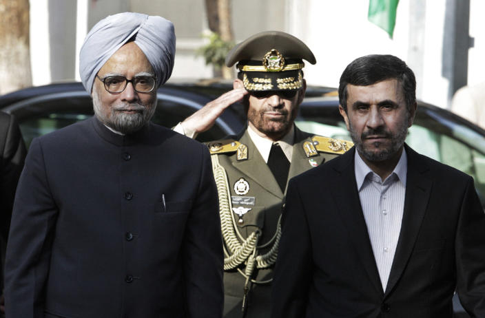 Indian Prime Minister Manmohan Singh, left, is welcomed by Iranian President Mahmoud Ahmadinejad, right, for a meeting, in Tehran, Iran, Wednesday, Aug. 29, 2012. (AP Photo/Vahid Salemi)
