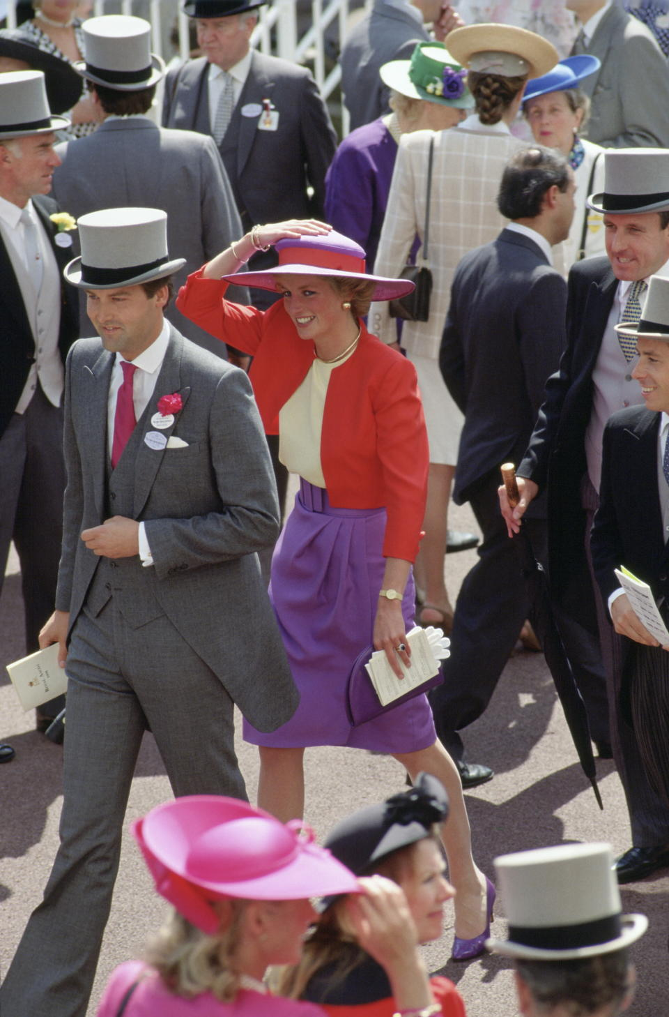 <p>The Princess looked perfect at Ascot in 1990 wearing a red and purple suit by Catherine Walker and a Philip Somerville hat. <em>[Photo: Getty]</em> </p>