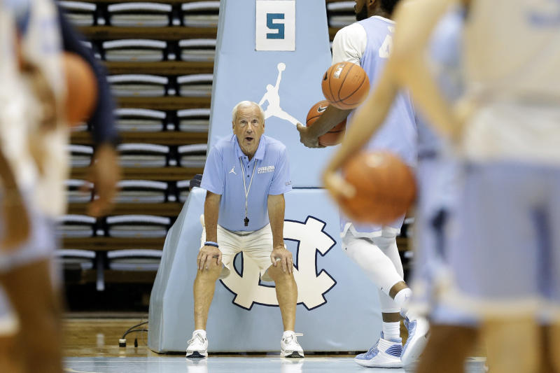 In this photo taken Wednesday, Oct. 2, 2019, North Carolina coach Roy Williams watches his team during an NCAA college basketball practice in Chapel Hill, N.C. (AP Photo/Gerry Broome)
