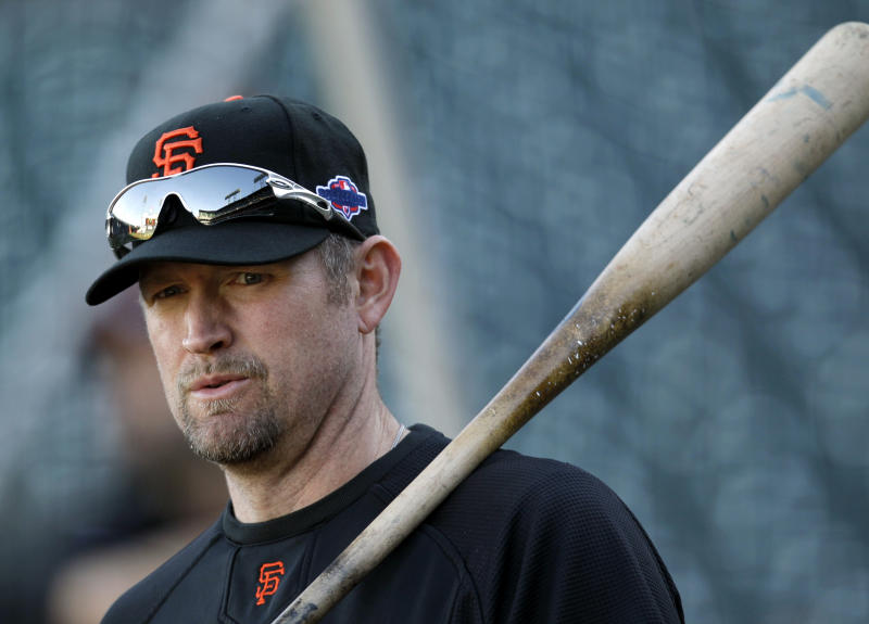 The Giants don't seem eager to associate themselves with Aubrey Huff these days. (AP Photo/Eric Risberg)