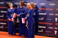 "Contestants Tulia of Poland pose on the ""Orange Carpet"" during the opening ceremony of the 2019 Eurovision Song Contest in Tel Aviv, Israel May 12, 2019. REUTERS/Amir Cohen"