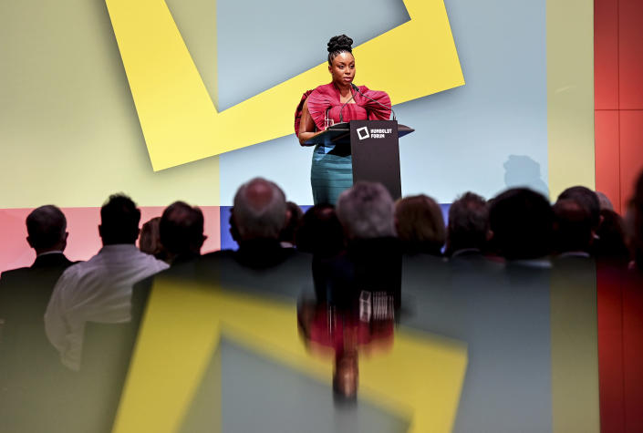 Writer Chimamanda Ngozi Adichie speaks during the ceremony marking the exhibition opening of the Ethnological Museum, the Museum of Asian Art of the National Museums in Berlin/Prussian Cultural Heritage Foundation and the Humboldt Forum Foundation in the Berlin Palace, Berlin, Germany, Wednesday Sept. 22, 2021. (Britta Pedersen/dpa via AP)