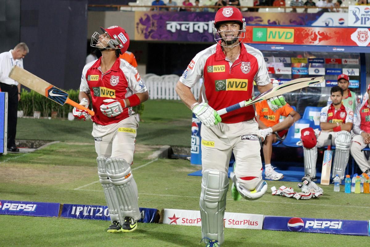 Opening batsmen Mandeep Singh and Adam Gilchrist walking out onto the field during match 35 of the Pepsi Indian Premier League between The Kolkata Knight Riders and the Kings XI Punjab held at the Eden Gardens Stadium in Kolkata on the 26th April 2013.  (BCCI)