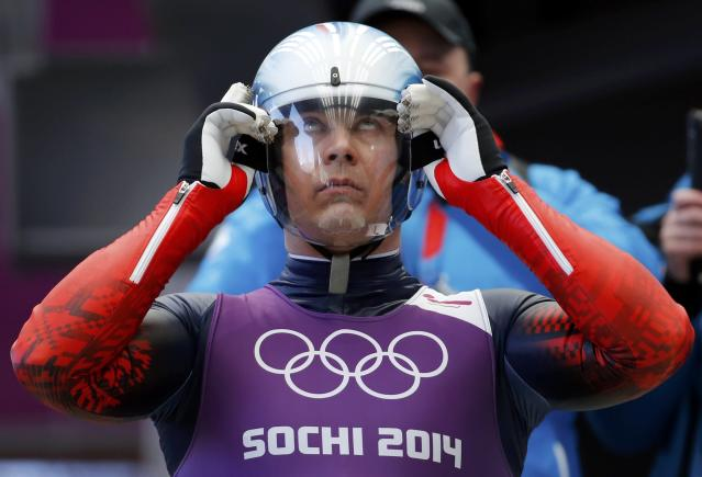 Russia's Albert Demchenko prepares for the start during the men's luge training at the Sanki sliding center in Rosa Khutor, a venue for the Sochi 2014 Winter Olympics near Sochi February 5, 2014. REUTERS/Fabrizio Bensch (RUSSIA - Tags: SPORT LUGE OLYMPICS)