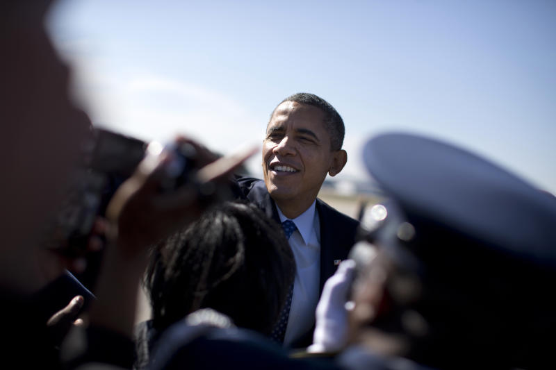 President Barack Obama shakes hands after arriving at Dobbins Air Reserve Base in Decatur, Ga., Thursday, Feb. 14, 2013,  before speaking to promote his economic and education plan that he highlighted in his State of the Union address.  (AP Photo/ Evan Vucci)