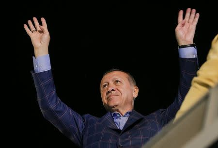 Turkish President Tayyip Erdogan greets his supporters in Istanbul