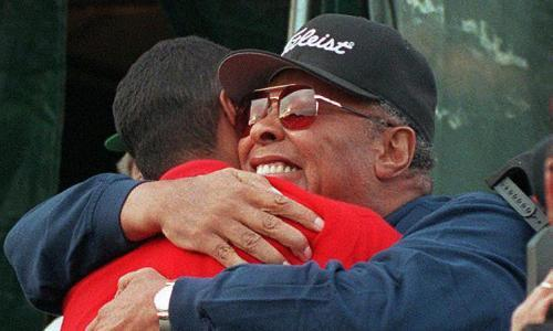 """<span class=""""element-image__caption"""">Tiger Woods is hugged by his father, Earl, after winning the 1997 Masters with a course-record 270, 18 under par and a 12-shot winning margin.</span> <span class=""""element-image__credit"""">Photograph: Bob Pearson/AFP/Getty Images</span>"""