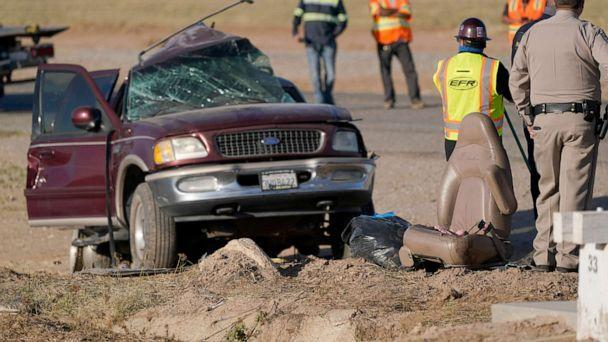 PHOTO: Law enforcement officers sort evidence and debris at the scene of a deadly crash in Holtville, Calif., March 2, 2021. (Gregory Bull/AP, FILE)