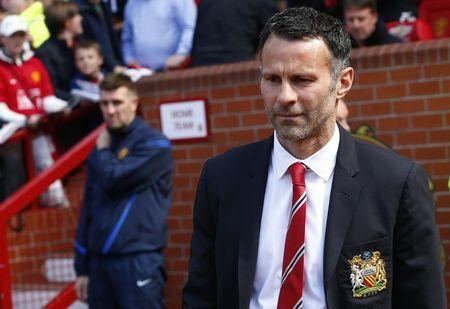 Manchester United caretaker player manager Ryan Giggs reacts during his side's English Premier League soccer match against Sunderland at Old Trafford in Manchester, May 3, 2014. REUTERS/Darren Staples
